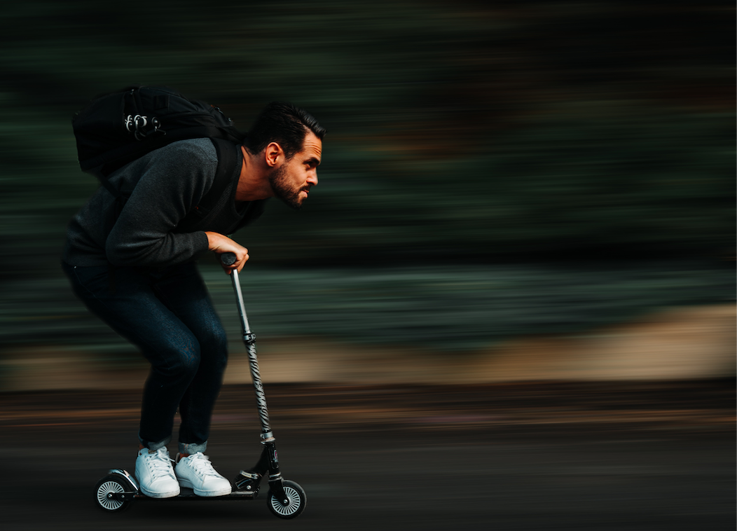 Man scootering at high speed.