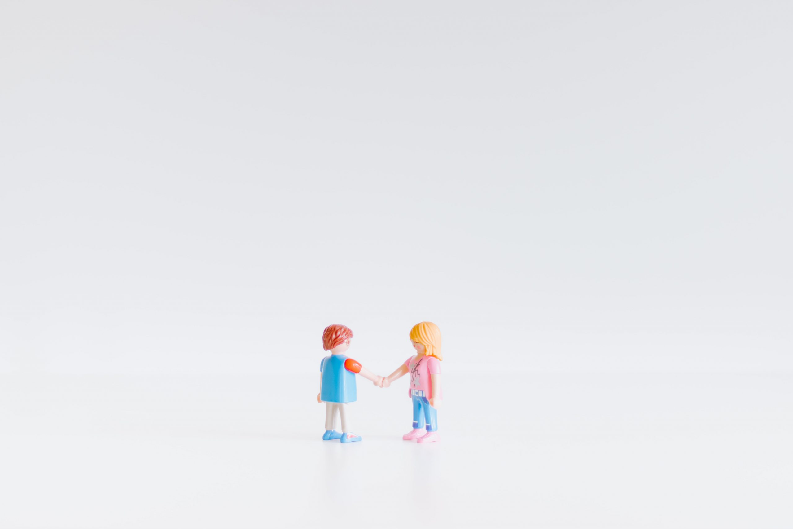 Small toys shaking hands.